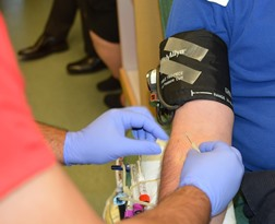 Chugiak AK phlebotomy student training to take blood